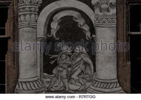 Slavonice, South Bohemia, Czech Republic: on c.1550 sgraffito façade, biblical scenes framed by columns etched between windows include this stabbing. - Stock Photo