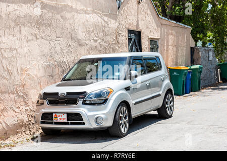 Key West, USA - May 1, 2018: Local car on street with license plate sign in Florida city travel, sunny day, parallel parked on street - Stock Photo