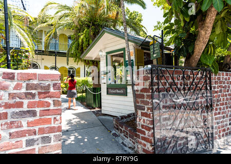 Key West, USA - May 1, 2018: Ernest Hemingway house sign famous entrance with admission ticket booth gate in Florida island - Stock Photo