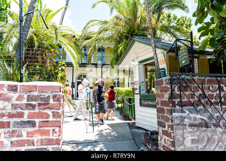 Key West, USA - May 1, 2018: Ernest Hemingway house famous entrance with admission ticket booth gate in Florida island - Stock Photo