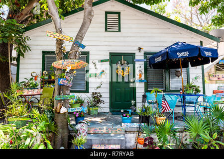 Key West, USA - May 1, 2018: Architecture of house in Florida city island on travel, sunny day, many decorations, local colorful design - Stock Photo