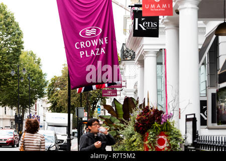 London, UK - September 16, 2018: Sign for Crowne Plaza hotel on Cromwell road street in Kensington, banner, white architecture - Stock Photo
