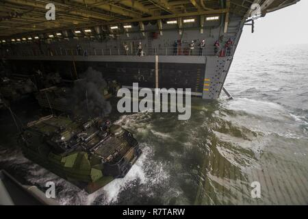 ATLANTIC OCEAN (April 5, 2017) An AAV-P7/A1 amphibious assault vehicle exits the well deck of the amphibious transport dock ship USS Arlington (LPD 24). The ship is underway conducting type commander sea trials in preparation for upcoming operations. - Stock Photo