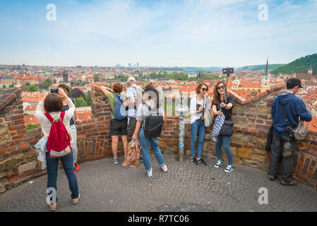 Tourists selfie, tourists take photos from a terrace on the Prague Castle Garden wall in the Hrad district, Prague, Czech Republic. - Stock Photo