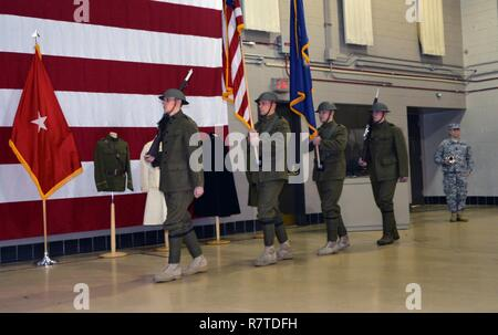 LATHAM, N.Y. --  Sgt. 1st Class Brian Swanhall stands by to play Taps as the World War I Doughboy Color Guard of the New York National Guard's 42nd Infantry Division march into the World War I centennial ceremony at the New York State Division of Military and Naval Affairs headquarters here on April 6. In addition to highlighting the 100th anniversary of the United States' entry into World War I, the ceremony also marked the beginning of New York State's World War I Centennial observances. The color guard troops are (from left to right): Spc. Kyle Williams of Amsterdam, N.Y.; Staff Sgt. Garbar - Stock Photo