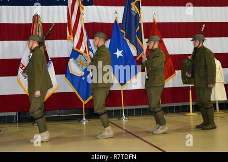 LATHAM, N.Y. --  The World War I Doughboy Color Guard of the New York National Guard's 42nd Infantry Division march into the World War I centennial ceremony at the New York State Division of Military and Naval Affairs headquarters here on April 6. In addition to highlighting the 100th anniversary of the United States' entry into World War I, the ceremony also marked the beginning of New York State's World War I Centennial observances. The color guard troops are (from left to right): Spc. Kyle Williams of Amsterdam, N.Y.; Staff Sgt. Garbarini of Copake, N.Y.; Sgt. Mike Crisalli of Clifton Park, - Stock Photo