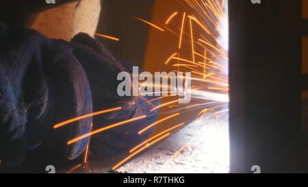 Industrial exposition. A welder doing his job. Welding close up - Stock Photo