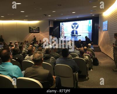 Air Force Deputy Director of Civil Engineers Edwin Oshiba addresses a full house during the civilian workforce development and wage grade panel session via a two-way live virtual teleconference that allowed for base attendees to directly ask personnel related questions. - Stock Photo
