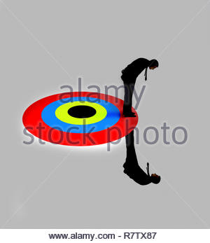 Businessman standing above and below target - Stock Photo