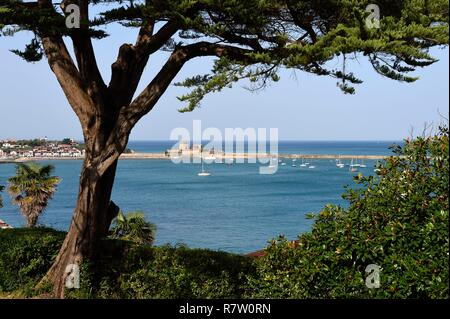 France, Pyrenees Atlantiques, Basque Country coast, Ciboure, the Villa Art Deco Leihorra, view from the garden on the Bay of Saint Jean de Luz and the Fort Socoa in the background - Stock Photo