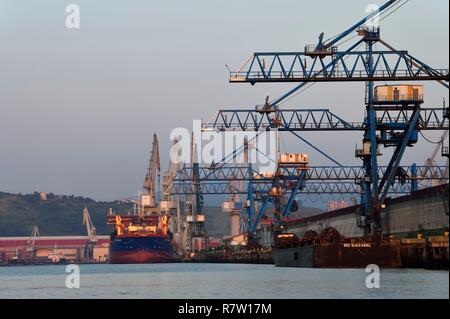 Spain, Basque Country, Biscay Province, Sestao, industrial port of Bilbao on the river Nervion centered on shipbuilding and also the iron and steel industry, ArcelorMittal plant on the right - Stock Photo
