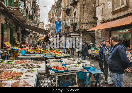Vendor at fishmonger stall at Via Sopramuro, Mercato di Porta Nolana quarter, Naples, Campania, Italy - Stock Photo