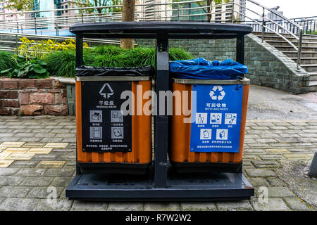 Shanghai Black and Blue Colored Residual and Recyclable Street Waste Bins - Stock Photo