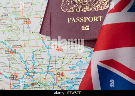 United Kingdom passport with Union Jack flag and map - Stock Photo