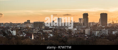 Panoramic view of the Brussels skyline at dusk taken from the Saint Susanna catholic church - Stock Photo