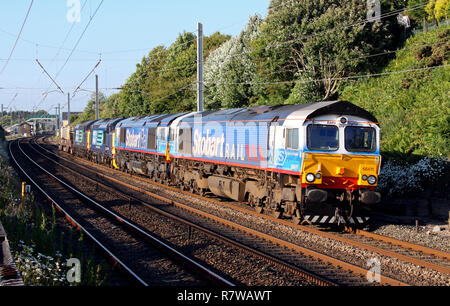 66411 & 66414  and two 37s pass Hest Bank with 6k73 Sellafield to Crewe nuclear flask train. - Stock Photo