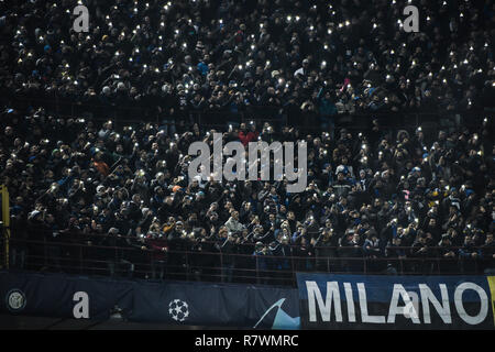 Milan, Italy. 11th December, 2018. Inter supporters in the inter north stands curva nord before the UEFA Champions League football match, Inter Milan vs PSV Eindhoven at San Siro Meazza Stadium in Milan, Italy on 11 December 2018 Credit: Piero Cruciatti/Alamy Live News - Stock Photo