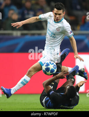 Milan, Italy. 11th Dec, 2018. PSV Eindhoven's Hirving Lozano (Top) competes during a Group B match of the UEFA Champions League between FC Inter and PSV Eindhoven in Milan, Italy, Dec. 11, 2018. The match ended with 1-1. Credit: Cheng Tingting/Xinhua/Alamy Live News - Stock Photo