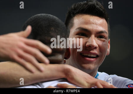 Milan, Italy. 11th Dec, 2018. PSV Eindhoven's Hirving Lozano (R) celebrates a goal during a Group B match of the UEFA Champions League between FC Inter and PSV Eindhoven in Milan, Italy, Dec. 11, 2018. The match ended with 1-1. Credit: Cheng Tingting/Xinhua/Alamy Live News - Stock Photo