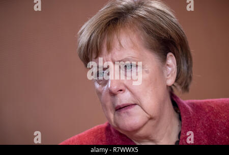 Berlin, Germany. 12th Dec, 2018. Chancellor Angela Merkel (CDU) is waiting for the start of the cabinet meeting at the Chancellor's Office. Credit: Michael Kappeler/dpa/Alamy Live News - Stock Photo