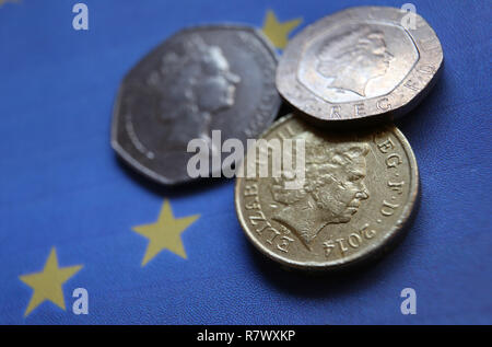 Kempten, Germany. 2nd Apr, 2017. ILLUSTRATION - British Pence and a one Pound coin lying on a European flag, photographed in Kempten, Germany, 2 April 2017. Credit: Karl-Josef Hildenbrand/dpa | usage worldwide/dpa/Alamy Live News - Stock Photo