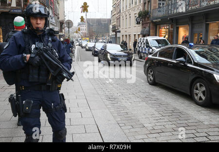 Strasbourg, France. 12th Dec, 2018. A policeman patrols in the center of Strasbourg, France on Dec. 12, 2018. French police are looking for a gunman after he killed at least four people and wounded 13 others Tuesday evening near a Christmas market in Strasbourg on the German border. Credit: Ye Pingfan/Xinhua/Alamy Live News Stock Photo