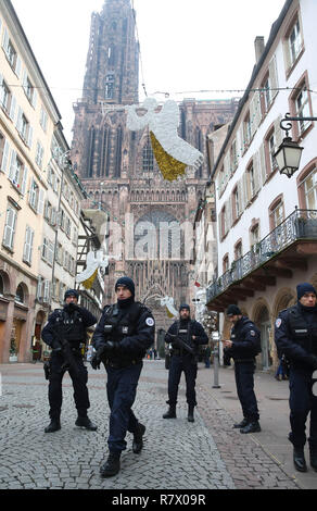 Strasbourg, France. 12th Dec, 2018. Policemen patrol in the center of Strasbourg, France on Dec. 12, 2018. French police are looking for a gunman after he killed at least four people and wounded 13 others Tuesday evening near a Christmas market in Strasbourg on the German border. Credit: Ye Pingfan/Xinhua/Alamy Live News Stock Photo