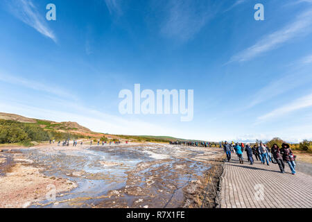 Haukadalur Valley, Iceland - September 19, 2018: Geyser landscape with people tourists in south Icelandic country, Hot Springs geothermal Golden Circl - Stock Photo