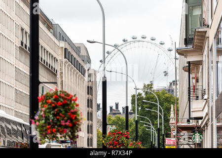 London, UK - September 12, 2018: Streetscape, Cityscape or skyline view of London Eye capsules, city, scaffold construction in Pimlico neighborhood di - Stock Photo