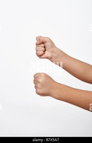 Kid hands ready to punch.Child aggression. - Stock Photo