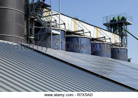 Silage towers with sun panels on the roof - Stock Photo