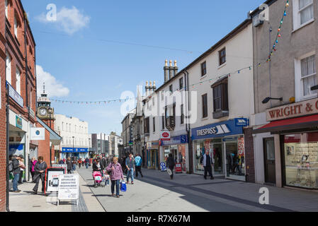 Street scene with people and shops in the city centre shopping precinct. High Street, Bangor, North Wales, UK, Great Britain - Stock Photo