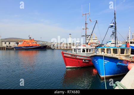 Fishing boats moored in the inner harbour with a lifeboat beyond. Kirkwall, Orkney Mainland, Scotland, UK, Great Britain - Stock Photo