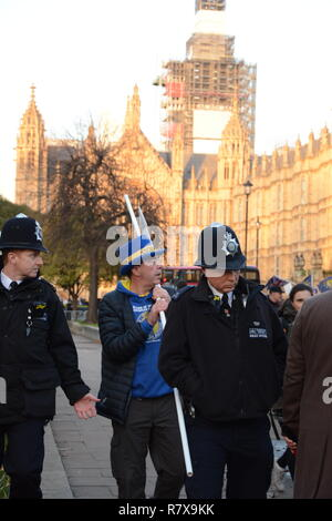 Steve Bray is escorted from College Green on the day of the Meaningful Vote (that never took place). 11th December 2018. - Stock Photo