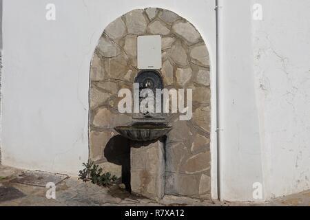 Old Public Drinking Water Fountain in Zahara de la Sierra, Spain - Stock Photo
