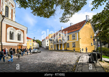Tourists walk cobbled streets past the Alexander Nevsky Cathedral the medieval upper town of Toompea Hill in the Baltic city of Tallinn, Estonia - Stock Photo