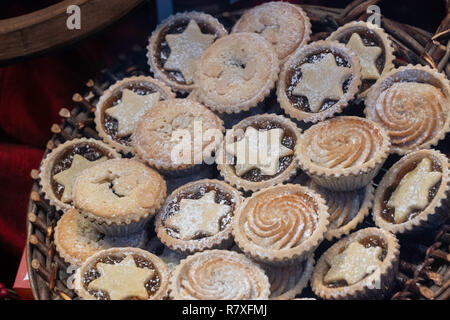 Assorted festive Mince Pies on display in a restaurant window. - Stock Photo