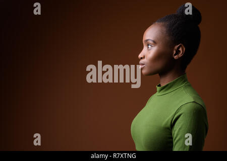 Profile view portrait of young African Zulu businesswoman - Stock Photo