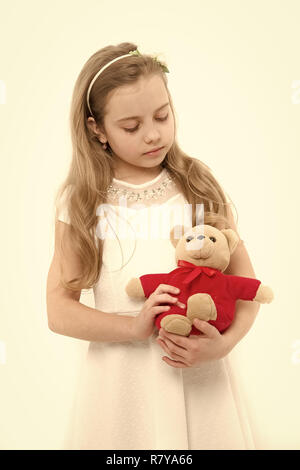 Child with teddy bear isolated on white. Girl play with soft toy. Birthday, anniversary celebration. Happy childhood concept. Holiday present and gift - Stock Photo