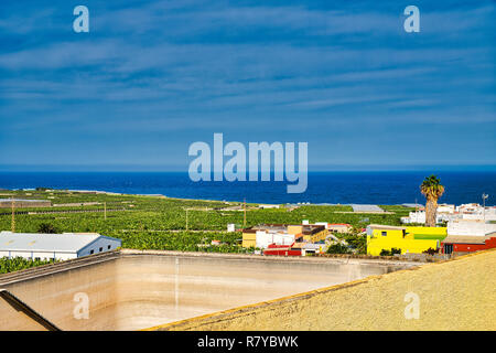 Los Silos the beautiful little town between the Atlantic coast and the Teno mountains - rainwater is very scarce, too, this water tank is empty. - Stock Photo