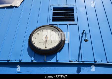 Clock on blue wall - Stock Photo