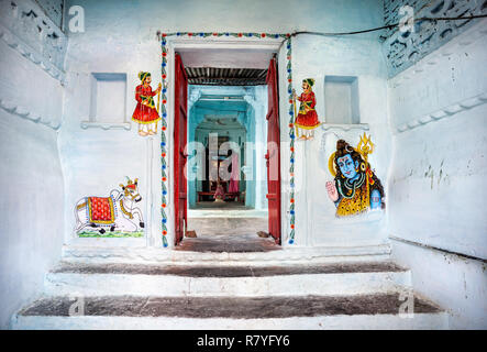 Traditional Rajasthan paintings on the Hindu temple wall in Udaipur, Rajasthan, India - Stock Photo