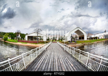 Pier in Ruh Ordo cultural complex near Issyk Kul lake at overcast sky in Cholpon Ata, Kyrgyzstan - Stock Photo