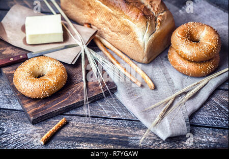 Bread with butter on wooden table - Stock Photo