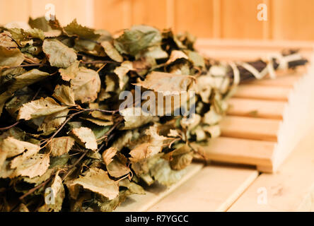 Birch broom and headrest in classic finnish sauna or bathroom interior. Health promotion in winter, cold prevention - Stock Photo