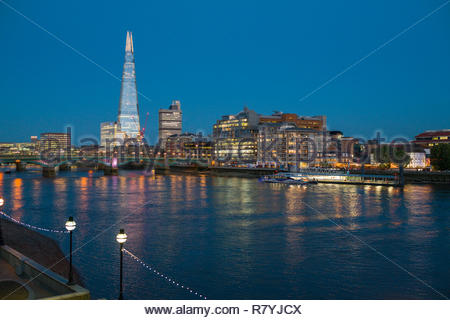 The Shard, a spire-like supertall skyscraper at sunset, Southwark, London, England, United Kingdom - Stock Photo