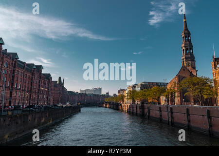 Hamburg, Germany - November 17, 2018: View of the Elbe river, going through the iconic Speicherstadt or old factory and warehouse district in the city