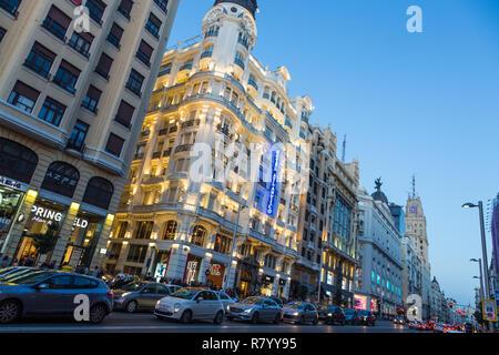 Madrid, Spain. Gran Via, main shopping street at dusk. - Stock Photo
