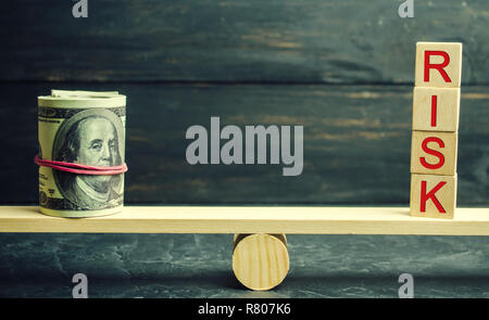 Dollars and the inscription risk are on the scales. The concept of financial and economic risk. Unreliable investment. Unpaid loan. Financial risk man
