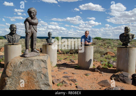 Carel Boshoff (jr) stands among the busts of South African Afrikaner presidents and generals, including his grandfather H.F. Verwoerd, the mastermind of Apartheid, in Orania, Northern Cape, December 13, 2013. Verwoerd is on the far left in this photo. Paul Kruger is on right. As South Africa has been ridding itself of its painful past by removing the busts from various public places around the country, Orania has been collecting them, building concrete pedestals to put them on.The statue of the small boy rolling up his sleeve is a symbol of Orania, this Afrikaner (only) town. ©Eva-Lotta Jansso - Stock Photo